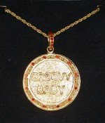 Groovy Baby Gold And Red Stoned Medallion